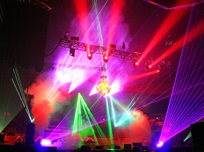 Korn assembles an arsenal of high powered full-color lasers for the North American arena tour. Using the new DMX Lightwave Laser Server, 10 lasers are controlled as automated fixtures from a full-size grandMA. The Korn Tour had one goal: attempt to use lasers as a replacement for automated lights.