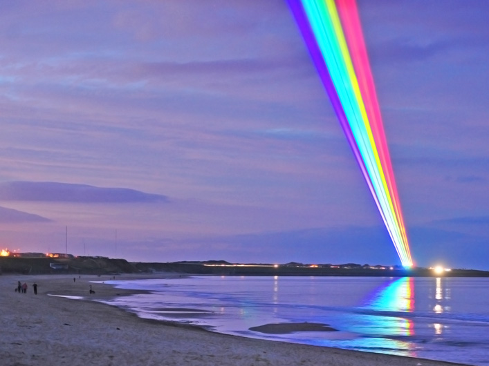 """The skies of North Tyneside in the UK are lit up with vibrant shafts of laser light marking the start of the Cultural Olympiad. Artist Yvette Mattern brings her """"Global Rainbow"""" work to the UK, powered by lasers from Lightwave International."""